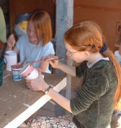 Painting a pot with underglaze